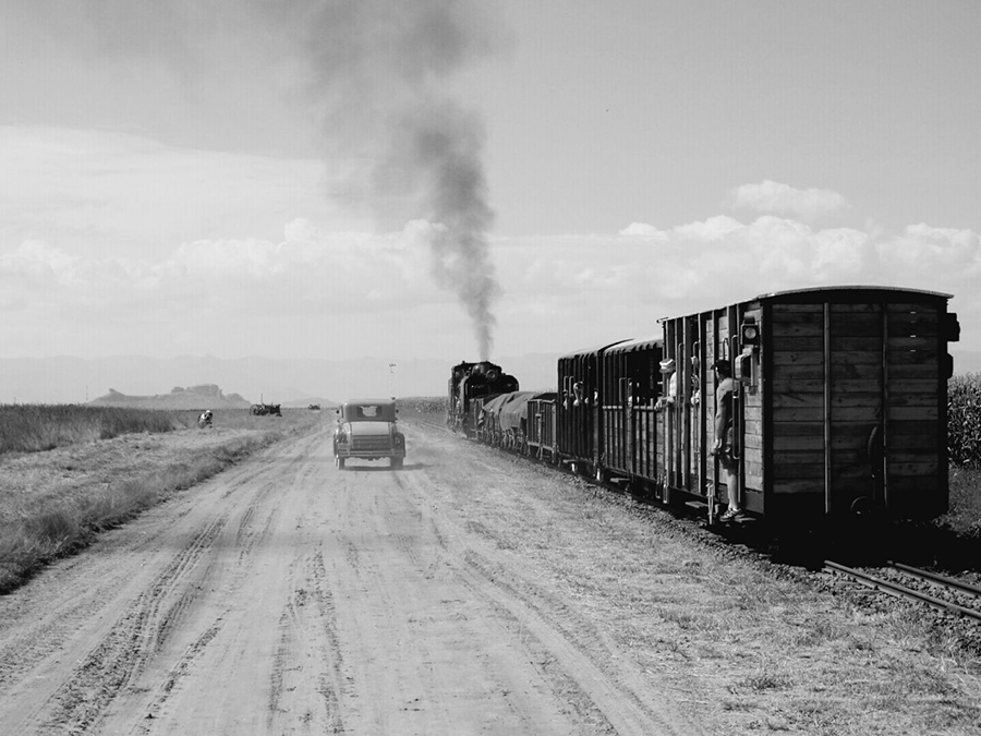 A scene from the past as a Ford Model A coupe overtakes the local passenger train Picture by Paul Koski