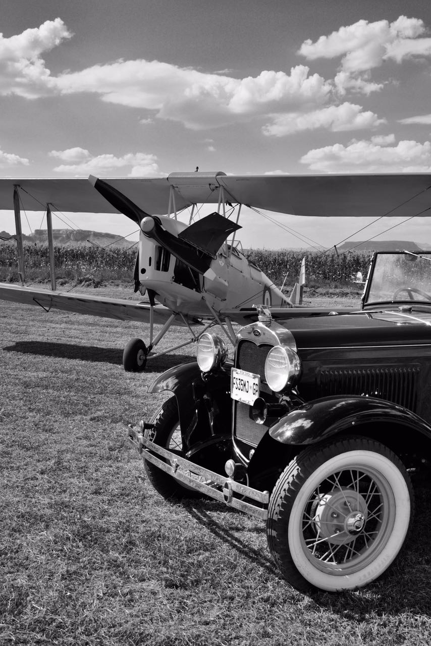 A scene from the 1930's, a Model A convertible and a Tiger Moth Picture by Lynette McCrystal